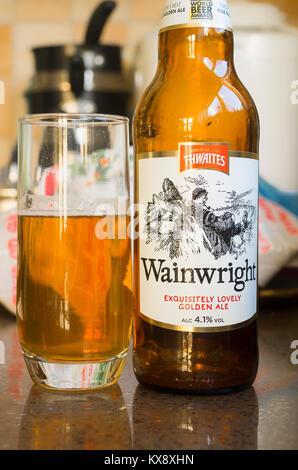 Bottle and glass of Thwaites Wainwright golden ale in UK - Stock Image
