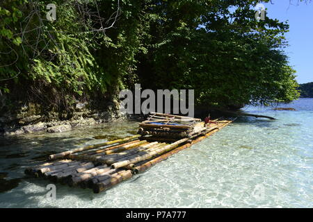 crystal water jamaica beach with bamboo raft - Stock Image