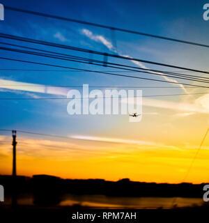 Landing Plane at Sunset - Stock Image