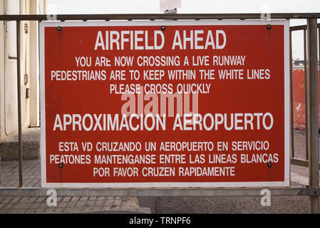 Warning sign at the Gibraltar airfield, Europe - Stock Image
