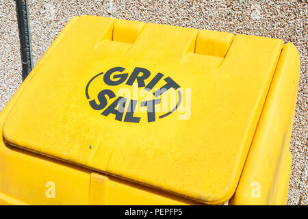 A yellow bin for grit and salt for winter weather Wrexham Wales June 2018 - Stock Image