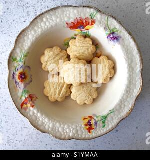 Butter biscuits in an antique bowl with floral print - Stock Image
