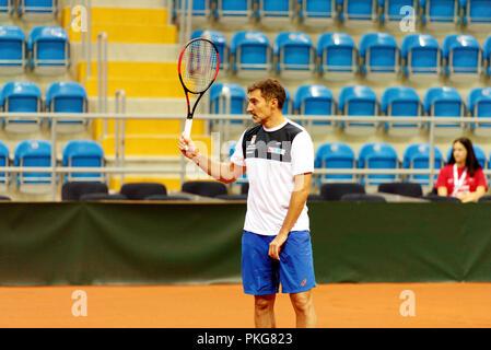 Kraljevo, Serbia. 13th September 2018. Nenad Zimonjic, captain of the Serbian Davis Cup tennis team, during a practice session for the 2018 World Group Play-off tie at the Sportski Center Ibar in Kraljevo, Serbia. Credit: Karunesh Johri/Alamy Live News. - Stock Image