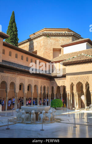 Tourists viewing the Court of the Lions and fountain at the Alhambra Palace in Granada Spain - Stock Image