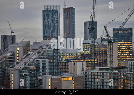 Manchester city centre skyline view across the rooftops from Salford 100 Greengate, The Edge apartment and Beetham tower - Stock Image