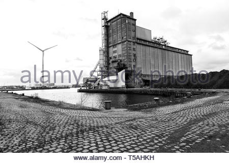 Antwerp, Belgium. Decomissioned and old fashioned grane silo on Amarica Docks of Antwerp Harbour. The entire industrial zone is subject to gentrificat - Stock Image