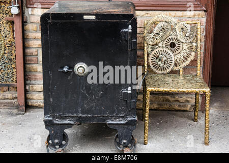 Old black, metal safe and sculpture chair made with keys by Phil Mortillaro at his Locksmith shop in Greenwich Village, - Stock Image