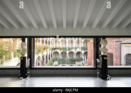 Interior view of an exhibition gallery of the the Ambrosiana Palace in Milan, home to the Pinacoteca Ambrosiana art gallery - Stock Image