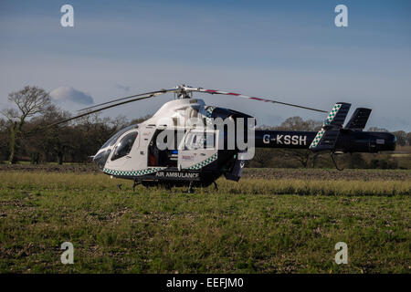 essex air ambulance landed in a field bicknacre - Stock Image
