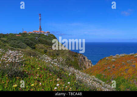 View of the lighthouse and cliff to the ocean, Cabo da Roca, Sintra, Portugal - Stock Image