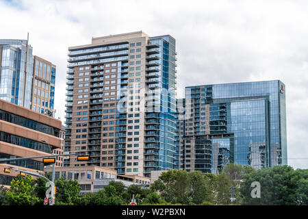 Dallas, USA - June 7, 2019: Downtown buildings in city near Klyde Warren park with sign for PWC - Stock Image