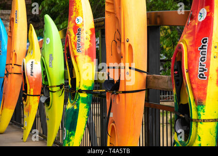 Colorful kayaks at the Paddle South Kayak Competition & Festival on the Chattahoochee River in Uptown Columbus, Georgia. (USA) - Stock Image