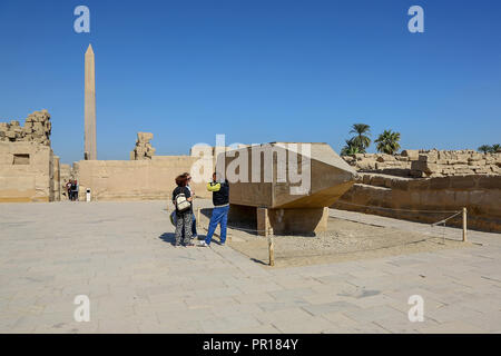 The fallen Obelisk and pyramidion of Queen Hapshetsut at the Karnak Temple Complex, also known as The Temple of Karnak, in Thebes, Luxor, Egypt - Stock Image