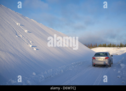 Toyota Avensis 2011 2.0 D4D on country road , Finland - Stock Image