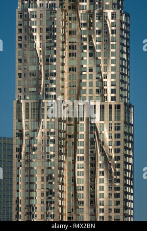 View of detail of Beekman Tower (8 Spruce Street) Lower Manhattan from Brooklyn Bridge, NYC on a sunny day - Stock Image