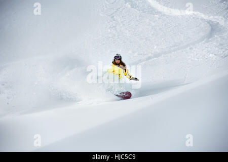 Girl snowboarder off-piste backcountry freeriding - Stock Image