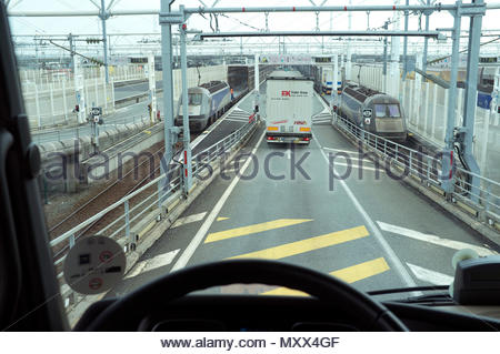 Lorry driver's view prior to boarding the Eurotunnel freight shuttle train at Calais/Coquelles, northern France. - Stock Image