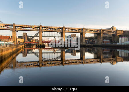 The High Level bridge and Tyne bridges reflected in the river, Newcastle upon Tyne, England, UK - Stock Image