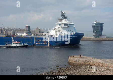 The Skandi Geosund oil support vessel sails out from Aberdeen to its North Sea oil platform destination. - Stock Image