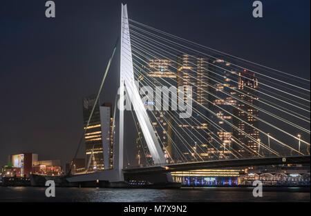 Erasmusbrug (Erasmus Bridge) and De Rotterdam buildings city skyline at night, Rotterdam, The Netherlands. - Stock Image