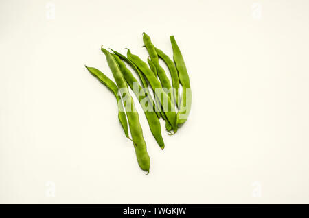 Group of immature tender green bean pods, ready to use for cooking food on white background - Stock Image