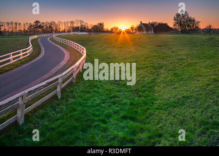 't Waarhuis in Aduarderzijl at sunset in the province of Groningen, Netherlands - Stock Image