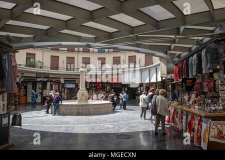 People at the circular shaped Plaza Redonda shopping and market, Calle San Vicente Martir, Valencia, Spain. - Stock Image