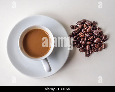 sill life of Espresso coffeo in white cup with roated beans - Stock Image