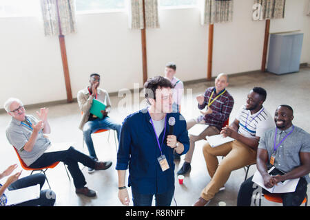 Group clapping for male speaker - Stock Image