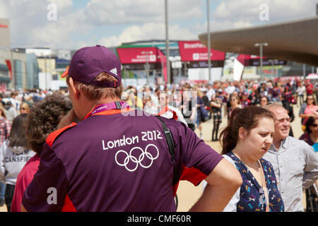 Helper guide on a sunny day at Olympic Park, London 2012 Olympic Games site, Stratford London E20 UK, - Stock Image