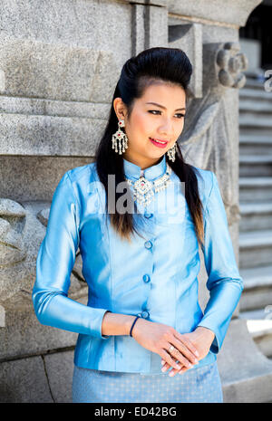 Thai woman wearing traditional attire - Stock Image
