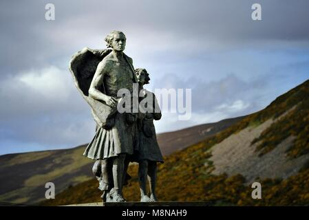 Highland Clearances memorial showing family evicted from glen home. Sited at Helmsdale, Sutherland, Scotland. Created - Stock Image