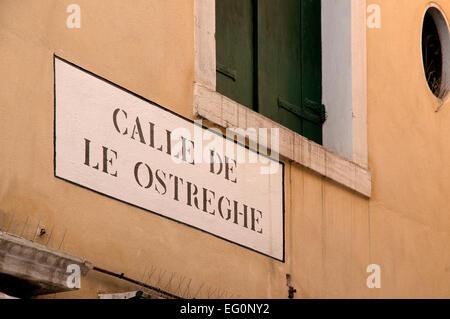 Street sign reading Calle de le Ostreghe Venice Italy - Stock Image