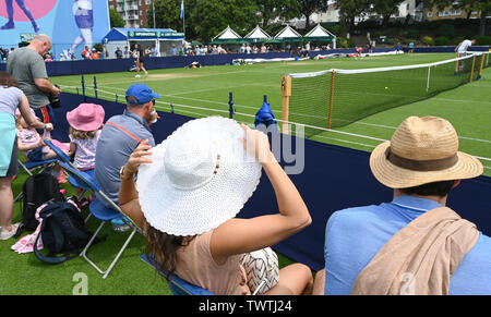 Eastbourne UK 23rd June 2019 - The sun hats are out at the Nature Valley International tennis tournament in Devonshire Park Eastbourne today on a hot but overcast day   . Credit : Simon Dack / Alamy Live News - Stock Image