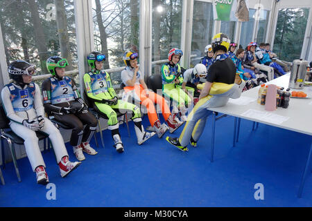 Ladies wait for the start of World Championship in Ski Jumping for women. Cabin on the top of Ski Jumping Hill Ljubno, - Stock Image