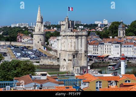 Tour de la Chaine and La Tour de la Lanterne or Tower of the Lantern in the Vieux Port in La Rochelle on the coast of the Poitou-Charentes region of F - Stock Image