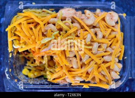 Cheese and prawn pasta salad,plastic container - Stock Image