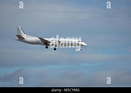 An Eastern Airways Saab 2000 (G-CERZ) on its approach to Aberdeen Airport in Grampian Region, Scotland. - Stock Image
