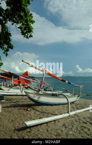 traditional fishing boats Jukung on beach in Lombok, Indonesia - Stock Image