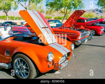 USA, Arizona, Buckeye. Orange and red classic cars on display. Credit as: Wendy Kaveney / Jaynes Gallery / DanitaDelimont.com - Stock Image