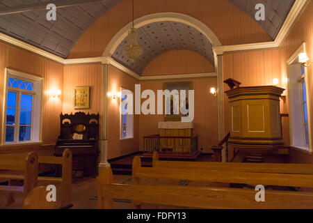 The neat interior of a small rural church in Iceland - Stock Image
