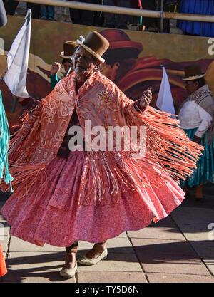 Cholita dancing in El Alto, La Paz, Bolivia - Stock Image