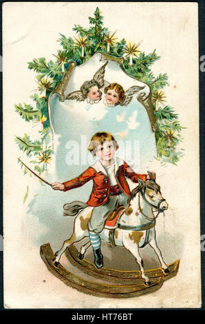 GERMANY - CIRCA 1915: A Christamas postcard printed in Germany, shows a little boy on a rocking horse, circa 1915 - Stock Image