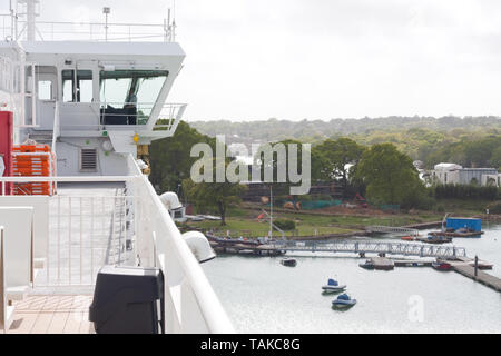 View of the ship's crew as seen from the deck of a passenger ferry - Stock Image