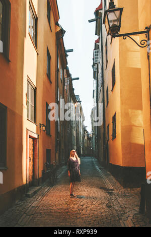 Travel in Stockholm woman walking alone lifestyle summer trip vacations in Sweden old city streets - Stock Image