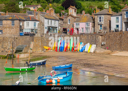 15 June 2018: Mousehole, Cornwall, UK - The harbour and village. - Stock Image