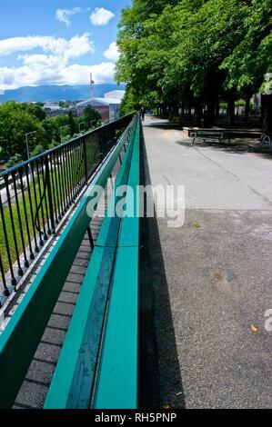120-metre-long World Longest wooden Park bench overlooks Bastions Park Geneva Switzerland built  1767 - Stock Image