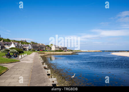 View along waterfront promenade beside Lossie River mouth on Moray Firth coast. Lossiemouth, Moray, Scotland, UK, Britain - Stock Image