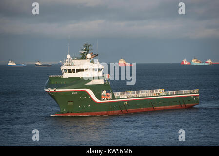 Erna Offshore cargo supply vessel making its way towards the Aberdeen harbour and docks for supplies. - Stock Image
