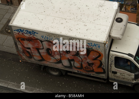 damage deface destroy dirty graffiti paint spray tag tagged tork truck - Stock Image